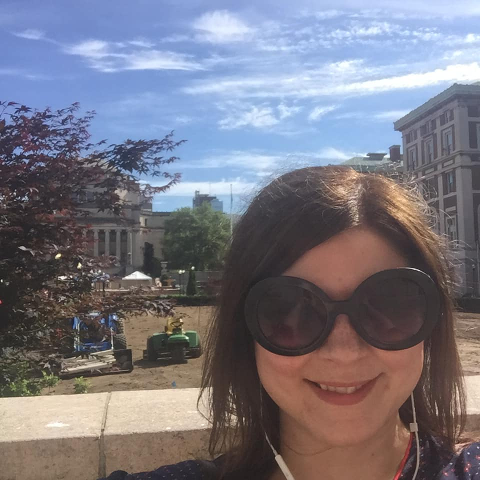 Beth Fowler standing in a courtyard at Columbia University