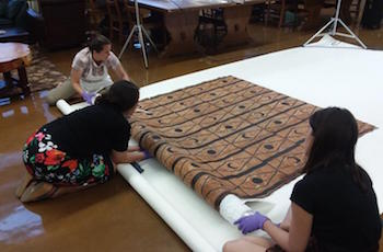 Christine Bisulca examines a Polynesian barkcloth at the Arizona State Museum.