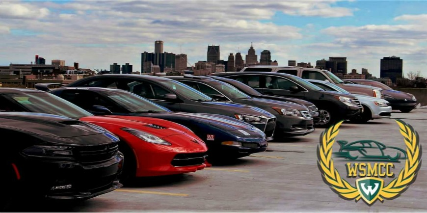 A fleet of cars line a Wayne State rooftop parking lot