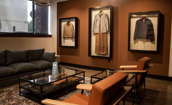 Historical artifacts, including the company's iconic overalls and coats, are displayed in the lounge of the Carhartt Workshop.