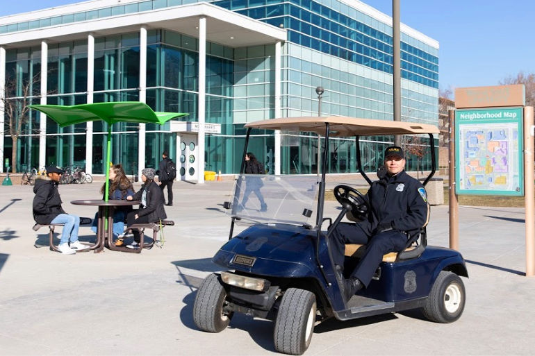 police officer on golf cart