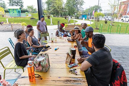 Alumni Fellows gather at Robert C. Valade Park on Detroit's East Riverfront