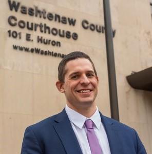 Prosecutor Eli Savit standing in front of the Washtenaw County courthouse