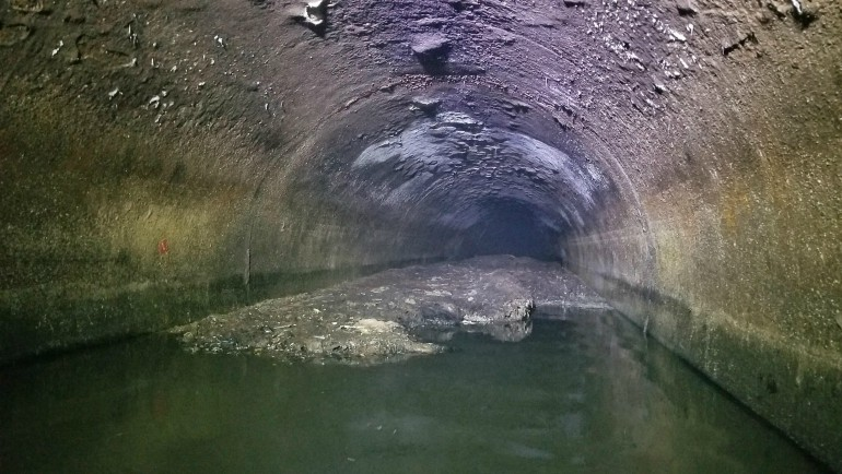 Fatberg in Macomb County sewer pip prior to its removal.