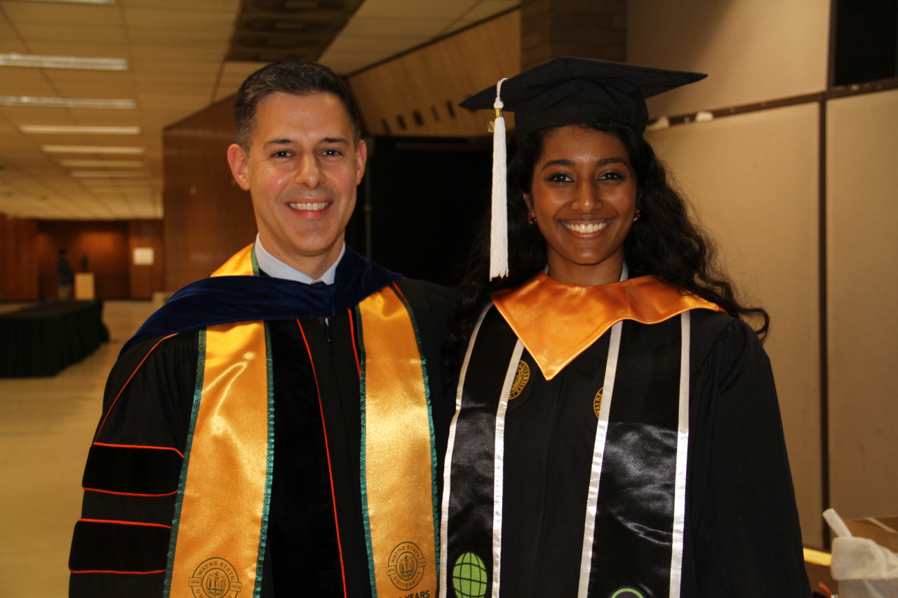Kavya Davuluri with Honors Dean John Corvino at Honors Commencement