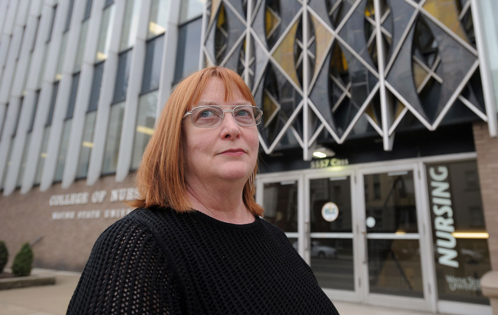 Photo of Dr. Margaret Campbell in front of Cohn Building