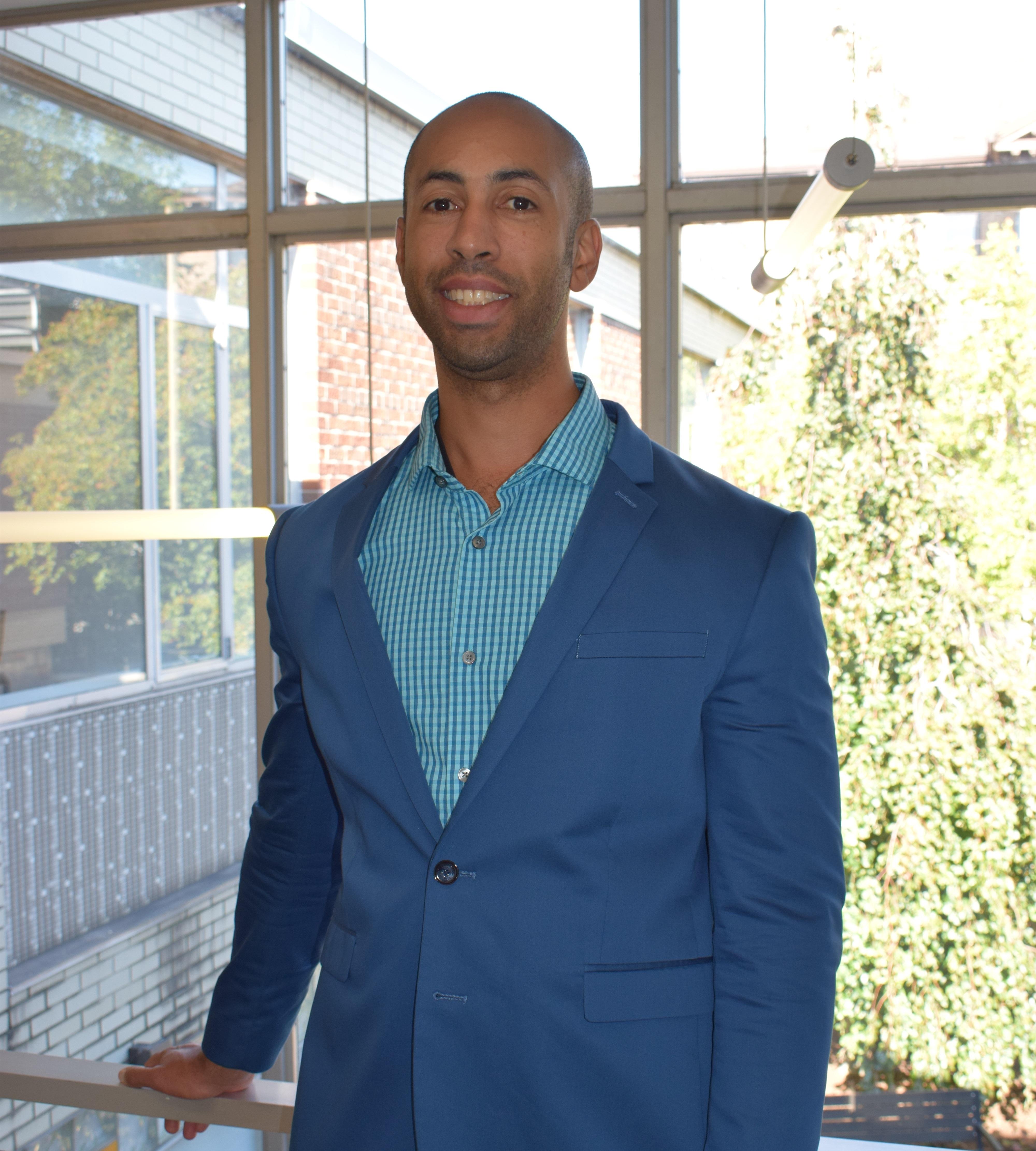 Michael Broman smiling inside the WSU School of Social Work