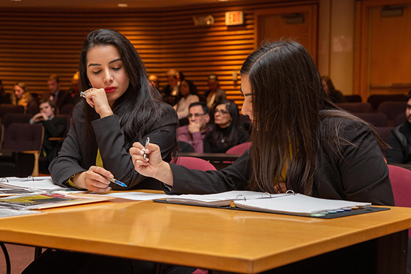 Lydia Mikail and Sabah Khadri, winners of fall 2019 Mock Trial In-House Competition, deliberate during the competition.