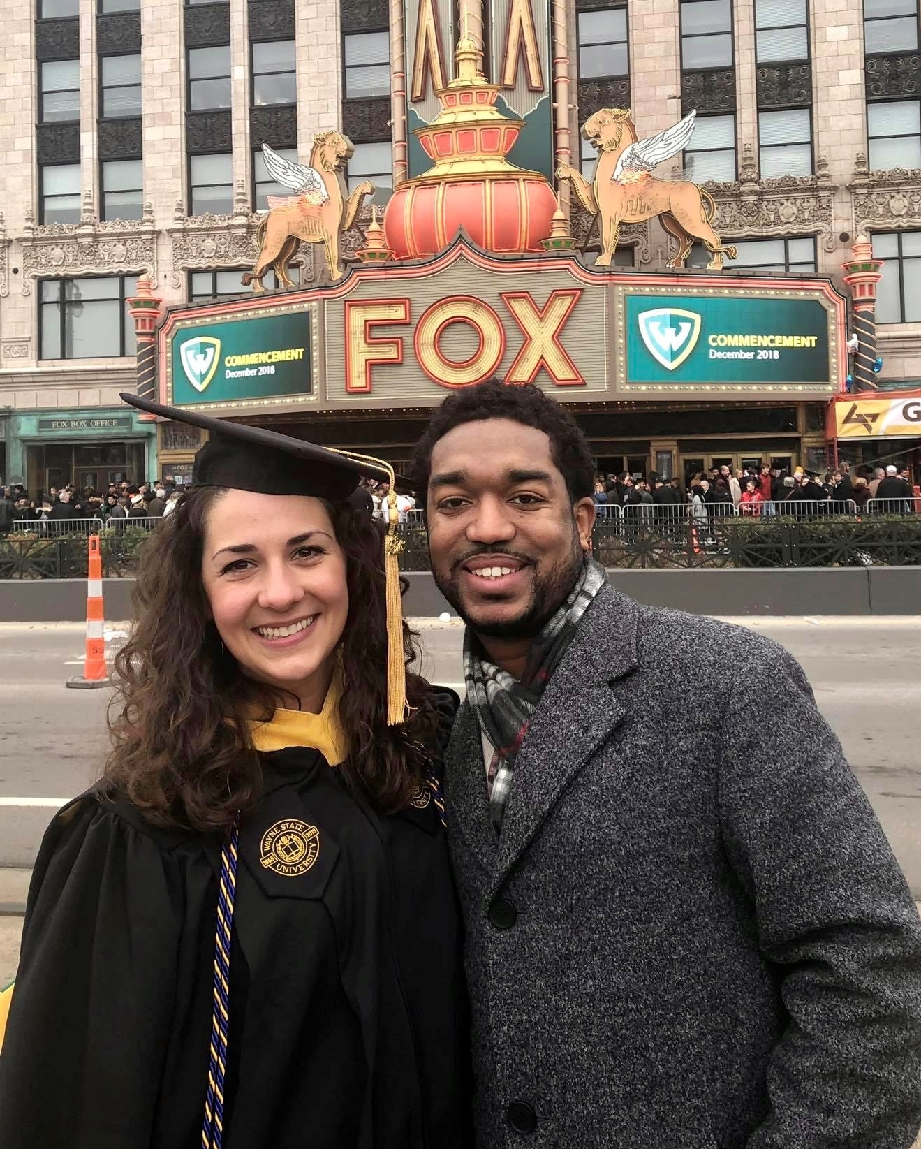 Nicole Hamhameh and husband smiling outside Fox Theatre at graduation