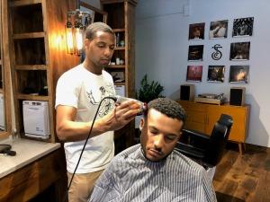 Social Club barber cuts hair