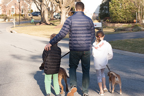 Stephen Ravas takes a walk with his children and their dogs.