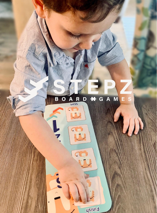 A child playing STEPZ board game