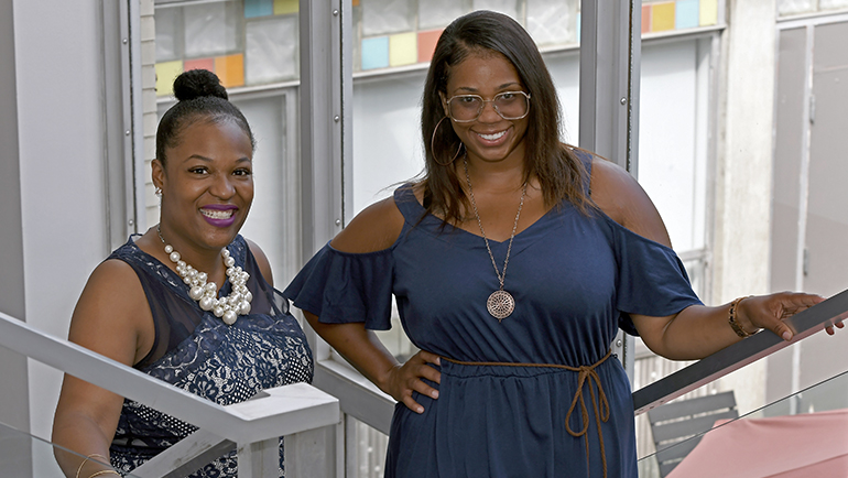 Airika Buford, Markita Terry stand together