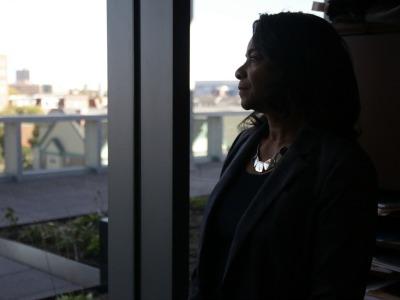 Dean Greer peers from her office window