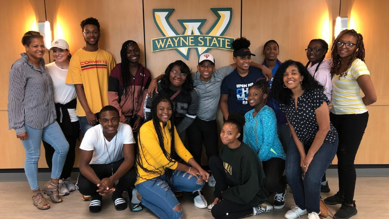 Actor/author Hill Harper poses with rising high school freshmen inside Wayne State's Student Center Building